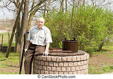 vieux, séance, puits, jambes, homme