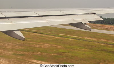 View Airplane Wing with Flaps while Landing - view of...