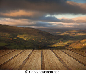 View along Swaledale in Yorkshire Dales National Park during Autumn sunrise with wooden planks floor
