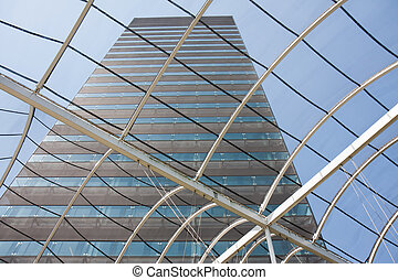 View at a big office building from within the entrance hall with glass roof