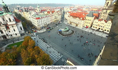 View at autumn sunset Prague central square from tower