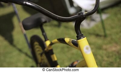 View at black and yellow creative bicycle staying on green...