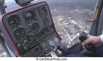 View at control system, pilot hold lever of helicopter....