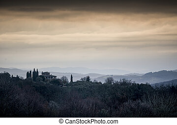 View at dawn across Tuscany from San Gusme