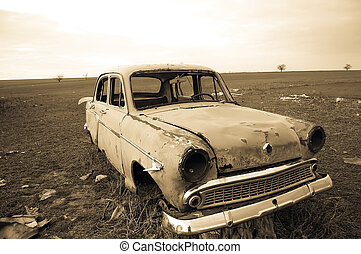View at old lonely car at countryside. Photo in old imge...
