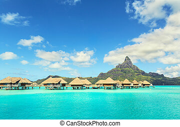View at Otemanu mountain and luxury bungalow at Bora Bora island, Tahiti, French Polynesia