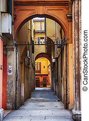 small typical street in Bologna, Italy