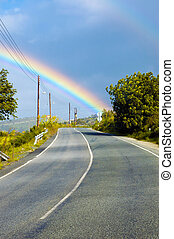 View at the rainbow above the road