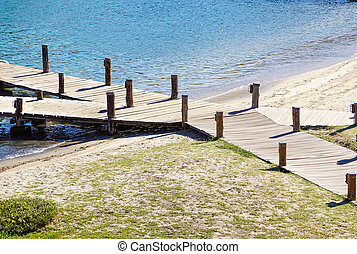 View at the sea from the wooden pier