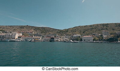 View Balaklava with a yacht that comes into the bay. Genoese...