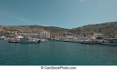 View Balaklava with a yacht that comes into the bay