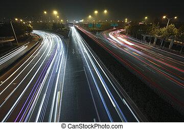 View dusk urban rainbow light night traffic on the highway