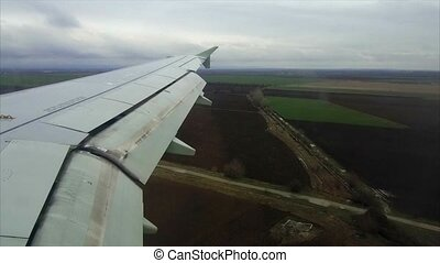 view flight plane window - Wing of airplane flying above the...