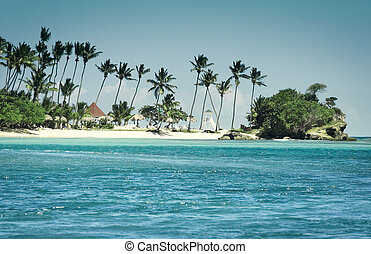 view from a bay to a caribbean island beach