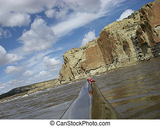 view from a bow of racing kayak on the North Platte River in...