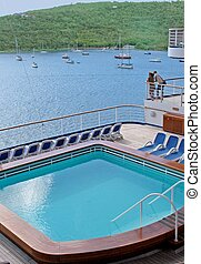 view from a cruise ship - view of pool and ocean from a...