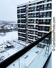 View from a window to a snow-covered street in winter
