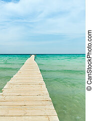 View from a wooden pier over the ocean