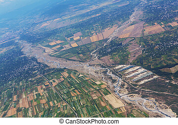 View from above - Aerial view of  green agricultural fields ...