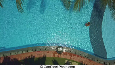 view from above lady goes out of pool water - view from...