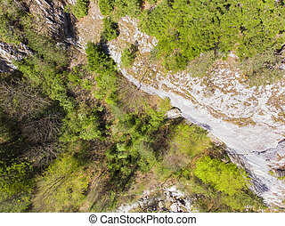 View from above of a rocky wall