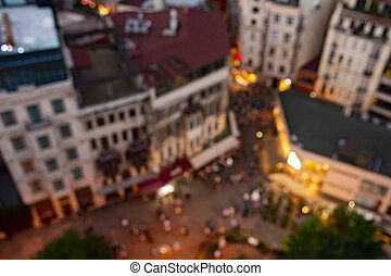 View from above of blurred (defocus) crowded city street and buildings at the sunset.