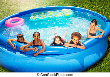 View from above of children group in swimming pool