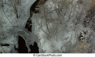 View from above of frozen river in forest