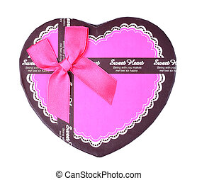 View from above of pink romantic heart-shaped gift box with ribbon isolated on a white background