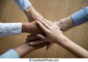 View from above of stacked business people hands