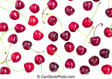 View from above on a fresh ripe red cherries on a white background