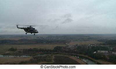 View from above on flying military helicopter - View from...