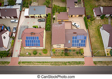View from above on houses roof with photovoltaic panels.