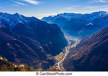 view from above on Maggia valley in canton Ticino with snowcapped mountains