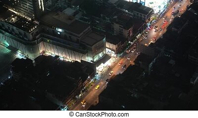 view from above on the traffic of a night city. cars are moving along the road. business center