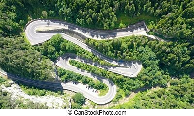 View from above over mountain curvy road in summer, time-...