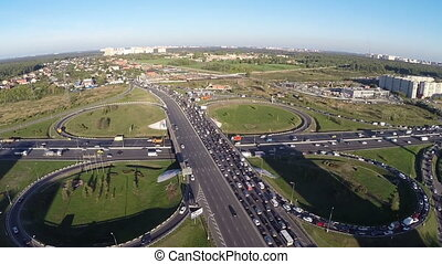 View from air of road interchange with city traffic - Aerial...