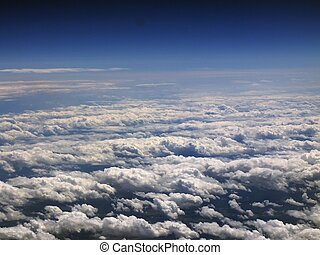 View from airplane - flight over clouds