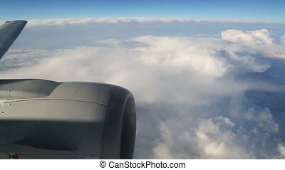 view from airplane on clouds wing and engine