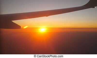 View from airplane window to beautiful sunrise or sunset....