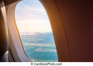 airplane window to see land and sky
