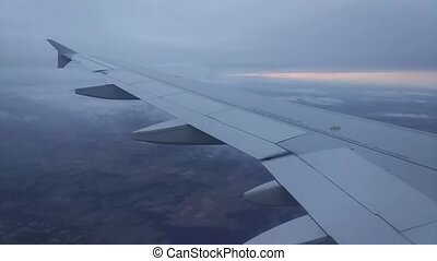 View from airplane window to the wing of an Airbus plane...