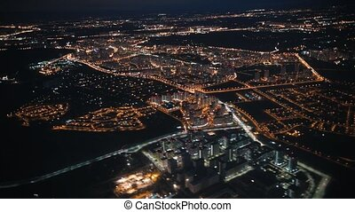 View from an airplane out the window of city. Night lights. Night view