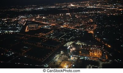 View from an airplane out the window of city. Night lights