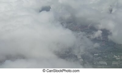 View from an airplane when landing on a cloudy area in Moscow Region stock footage video