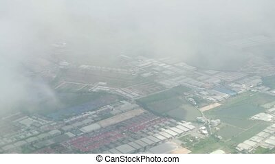 View from an airplane when landing on a cloudy area in Moscow Region