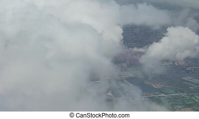 View from an airplane when landing on a cloudy area in...