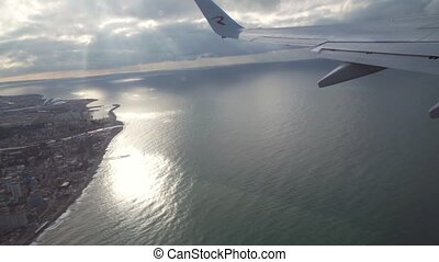 View from an airplane window on the city of Sochi and Black Sea stock footage video