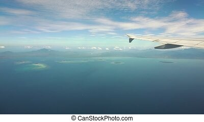 View from an airplane window on the ocean. - Airplane flying...