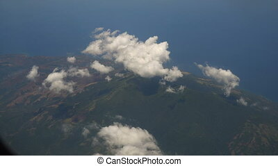 View from an airplane window on the ocean. - View through an...